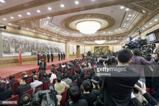 Members of the media observe as Xi Jinping China's president and general secretary of the Communist Party of China on stage from left speaks at the...