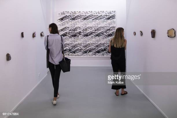Members of the media observe 'Carbon' by artist Tanya Goel which is part of the 31st Biennale of Sydney at Art Space on March 13 2018 in Sydney...