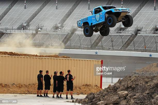 Members of the media participate during Speed Energy Super Trucks ridealongs with former NASCAR/INDYCAR star Robby Gordon at Texas Motor Speedway on...