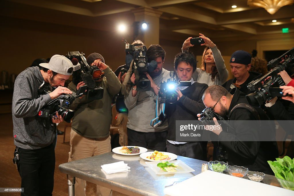 Members of the media photograph and capture food and beverage items as The Beverly Hilton reveals the menu for the 72nd annual Golden Globe awards held at The Beverly Hilton Hotel on January 5, 2015 in Beverly Hills, California.