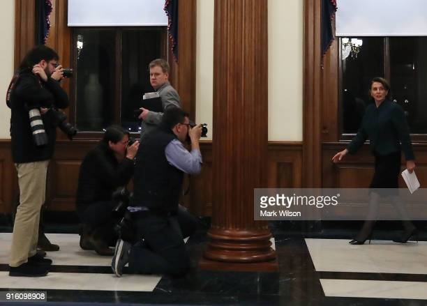 Members of the media photograph House Minority Leader Nancy Pelosi after the House voted to keep the government open on February 9 2018 in Washington...