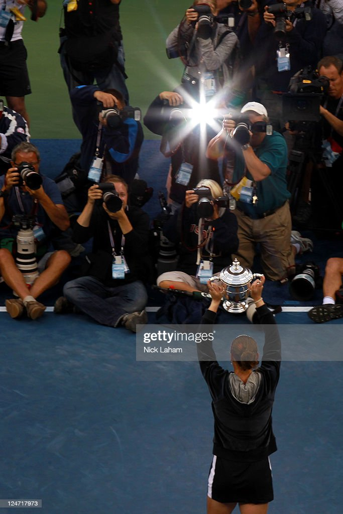Members of the media photograph Samantha Stosur of Australia as she celebrates with the championship trophy after defeating Serena Williams of the United States to win the Women's Singles Final on Day Fourteen of the 2011 US Open at the USTA Billie Jean King National Tennis Center on September 11, 2011 in the Flushing neighborhood of the Queens borough of New York City.