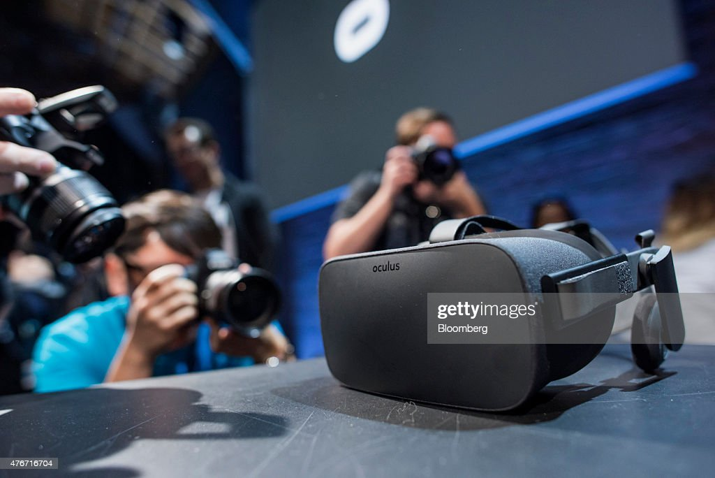 Members of the media photograph the new Oculus VR Inc. Rift headset during the 'Step Into The Rift' event in San Francisco, California, U.S., on Thursday, June 11, 2015. Facebook Inc.'s Oculus virtual-reality headsets will work with Microsoft Corp.'s Windows 10 and use the software maker's wireless Xbox game controller. Photographer: David Paul Morris/Bloomberg via Getty Images