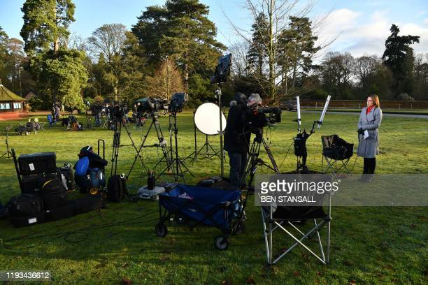 Members of the media prepare to make their broadcast report outside the Sandringham Estate, the private residence of Britain's Queen Elizabeth II, in...
