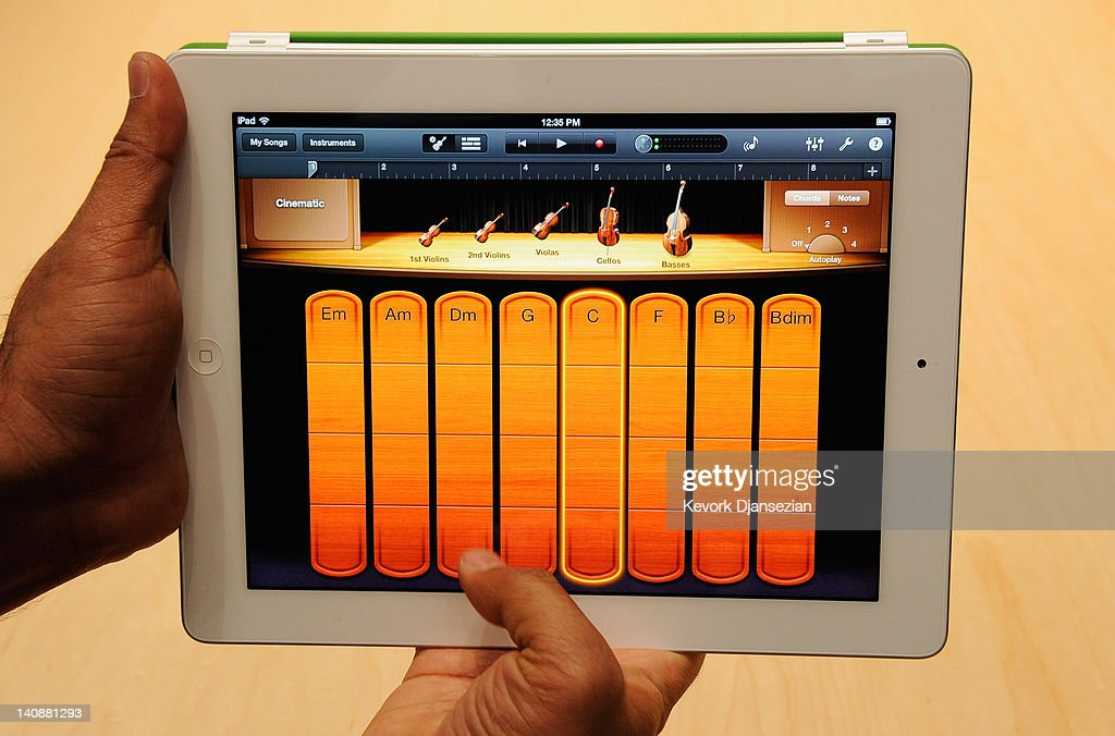 Members of the media preview the new iPad with the Garage band app
