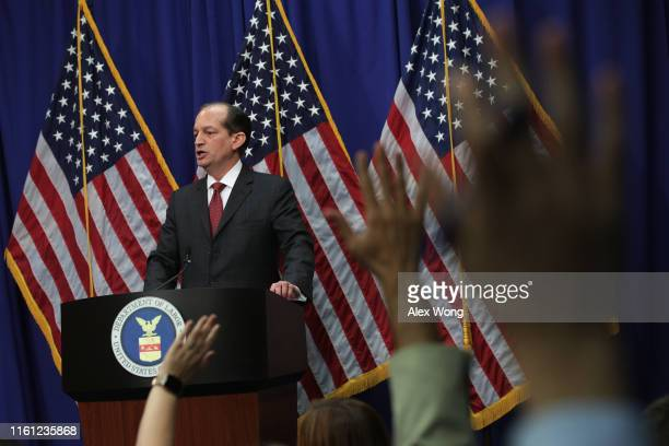 Members of the media raise their hands to ask questions as US Secretary of Labor Alex Acosta speaks during a press conference July 10 2019 at the...