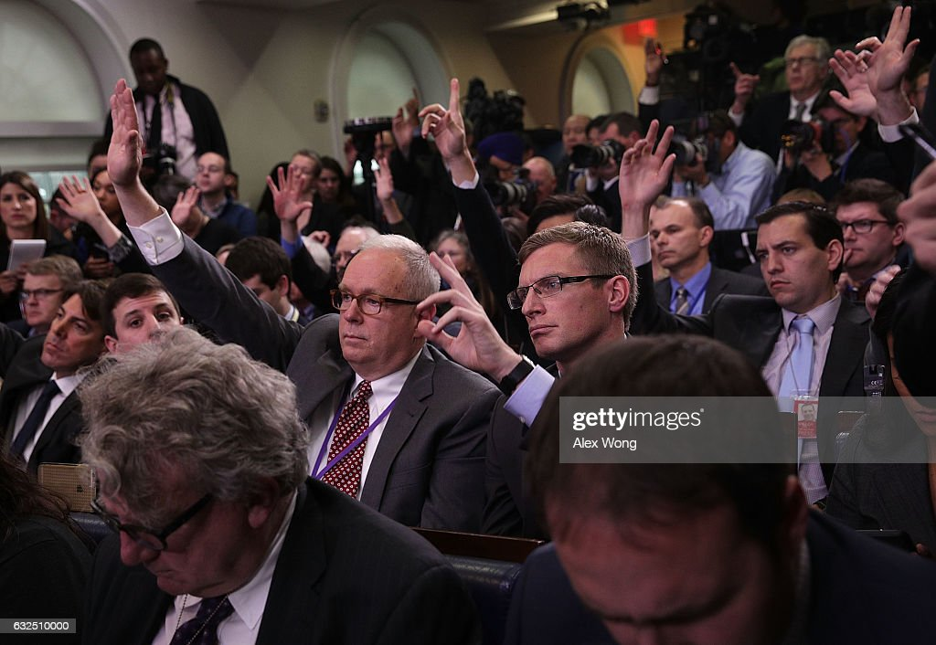 Members of the media raise their hands to ask questions during a daily briefing conducted by White House Press Secretary Sean Spicer at the James Brady Press Briefing Room of the White House January 23, 2017 in Washington, DC. Spicer conducted his first official White House daily briefing to take questions from the members of the White House press corps.