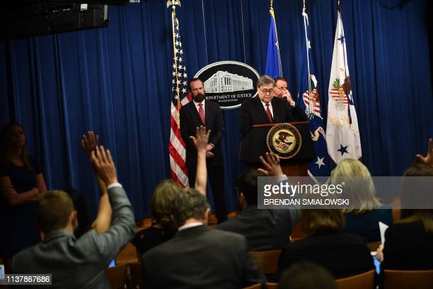 Members of the media raise their hands with questions as US Attorney General William Barr speaks about the release of the redacted version of the...