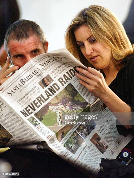 Members of the media read the November 19 edition of the Santa Barbara NewsPress giving details of the raids on the ranch owned by Michael Jackson...