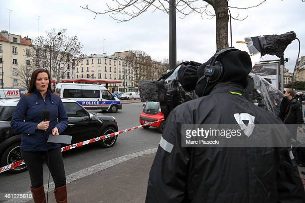 Members of the media record their reports from outside the kosher market 'Hyper Cacher' which suffered a terrorist attack yesterday on January 10...
