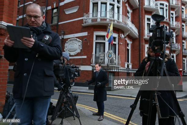 Members of the media report from outside the Ecuadorian embassy in central London on February 6 the day that a British judge said she would issue a...