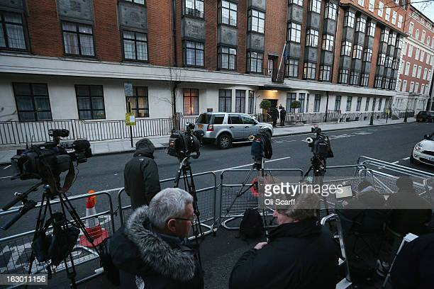 Members of the media report from outside the King Edward VII Hospital where Queen Elizabeth II has been admitted after suffering from symptoms of...