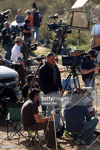 Members of the media report on the fighting between Israel and Hamas January 7 2009 along the Israeli Gaza border in Israel Despite protests and...
