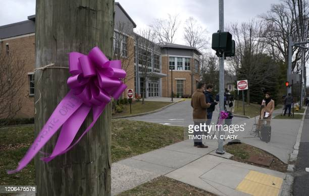 Members of the media report outside the Young Israel of New Rochelle synagogue in New Rochelle New York on March 10 at the centre of a Westchester...