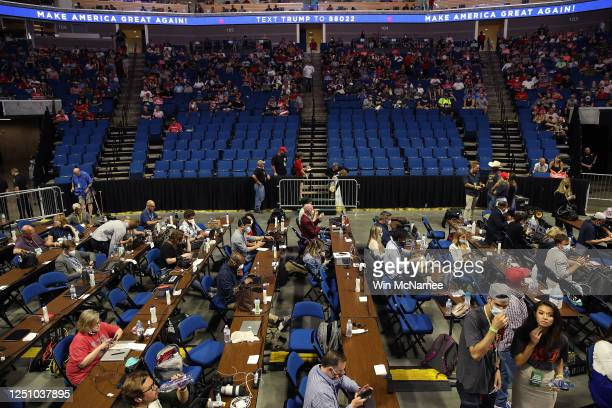 Members of the media sit at tables during a campaign rally for U.S. President Donald Trump at the BOK Center, June 20, 2020 in Tulsa, Oklahoma. Trump...