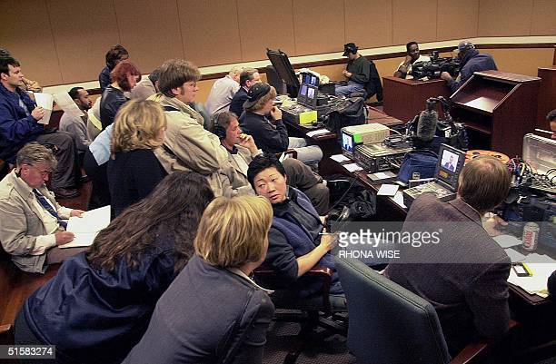 Members of the media sit in a press court room and watch German Tennis star Boris Becker testify in a preliminary divorce hearing 04 January 2001 in...