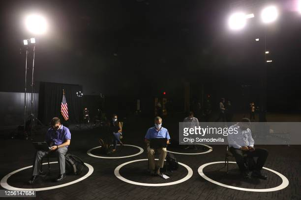 Members of the media sit in social distancing circles ahead of Democratic presidential candidate former Vice President Joe Biden's speech at the...