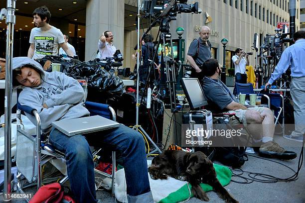 Members of the media sit outside of 71 Broadway where Dominique Strauss-Kahn, the former International Monetary Fund Managing Director charged with...