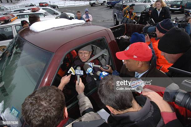 Members of the media speak with Joe Junta who with another hunter checked in two bears during the hunt while Lieutenant Kelly Gottiheiner yells at...
