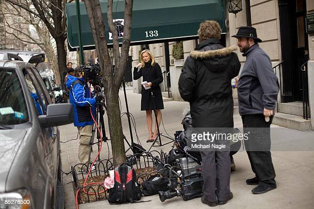 Members of the media stand in front of the apartment building where financier Bernard Madoff is under house arrest on March 6 2009 in New York City...