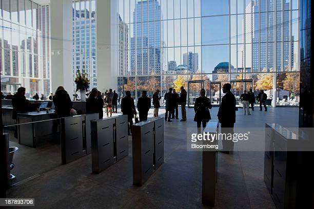 Members of the media stand in the lobby of 4 World Trade Center after a dedication ceremony in New York US on Monday Nov 4 2013 4 World Trade Center...