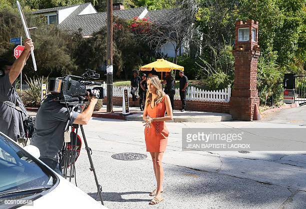 Members of the media stand near the area of Brad Pitt and Angelina JoliePitt's house located in Los Feliz California on September 20 2016 Angelina...