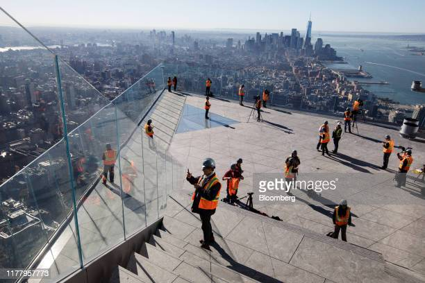 Members of the media stand on the Edge observation deck at 30 Hudson Yards during a media preview event in New York US on Thursday Oct 24 2019 Edge...