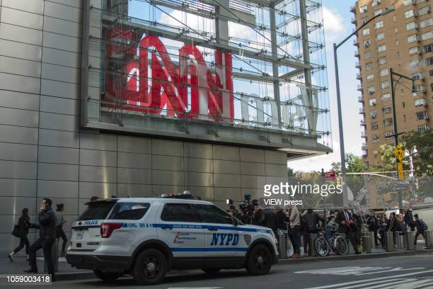 Members of the media stand outside the Time Warner Center in New York after a suspected explosive device was found in the building after it was...