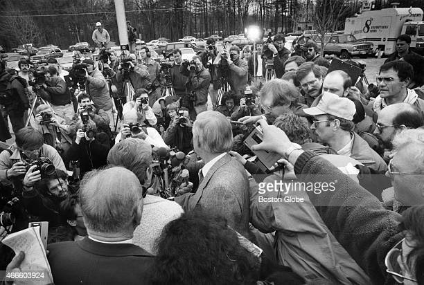 Members of the media surround Judith and William Smart parents of murder victim Gregory Smart at the Rockingham Superior Court in Exeter NH on March...