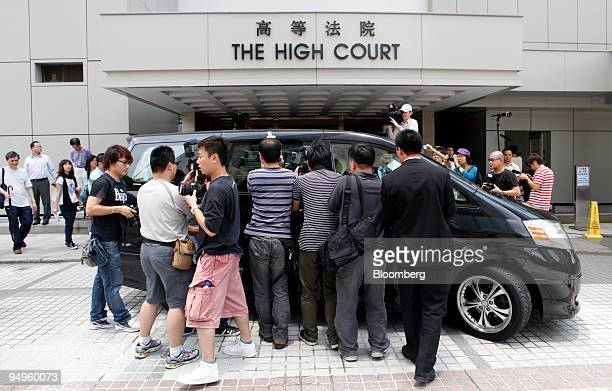 Members of the media surround the car of Tony Chan feng shui master as he leaves the High Court after testifying in the Nina Wang estate trial in...