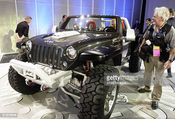Members of the media take a close look at the Jeep Hurricane concept car made by DaimlerChrysler 09 January 2005 during the North American...