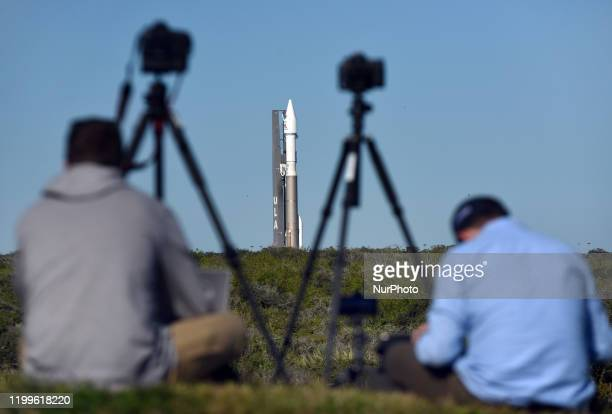 Members of the media take photographs as a United Launch Alliance Atlas V 411 rocket with the Solar Orbiter payload rolls out from the vertical...