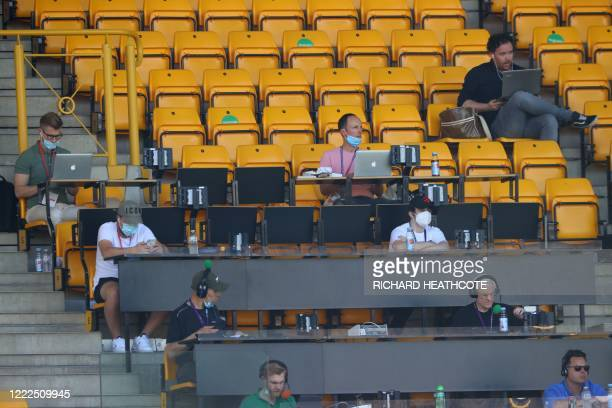 Members of the media take their seats, socially distanced ahead of the English Premier League football match between Wolverhampton Wanderers and...