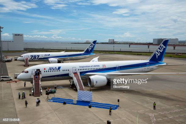 Members of the media tour a Boeing Co 7879 Dreamliner aircraft operated by All Nippon Airways Co during the unveiling at Haneda Airport in Tokyo...