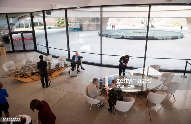 Members of the media tour Japanese artist Hiroshi Sugimoto's redesign of the Smithsonian's Hirshhorn Museum lobby and cafe at the Museum in...