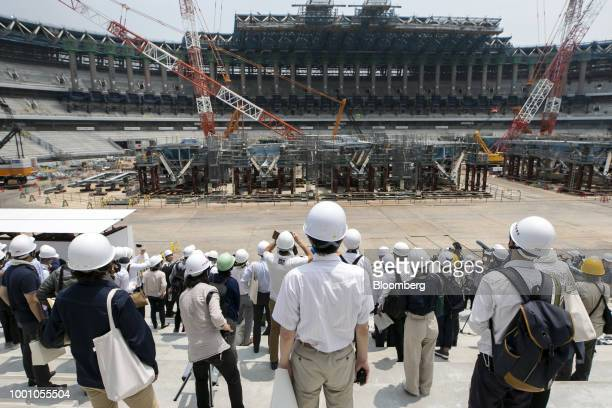 Members of the media tour the construction site of the New National Stadium the main venue for the Tokyo 2020 Olympic and Paralympic Games in Tokyo...