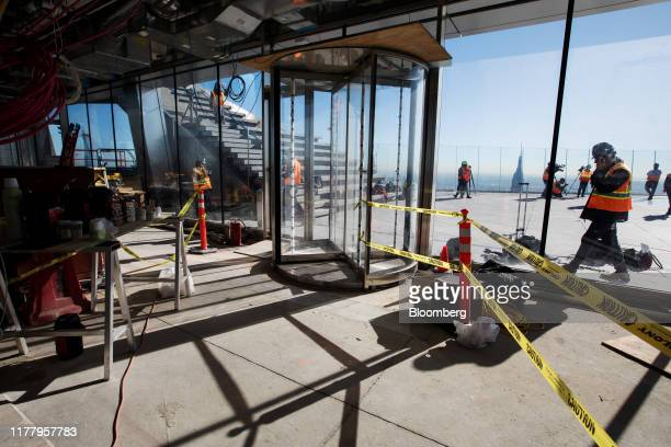 Members of the media tour the Edge observation deck at 30 Hudson Yards during a media preview event in New York US on Thursday Oct 24 2019 Edge is...