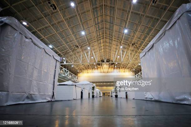 Members of the media tour the field hospital setup for coronavirus patients at the Ernest N Morial Convention Center on April 04 2020 in New Orleans...