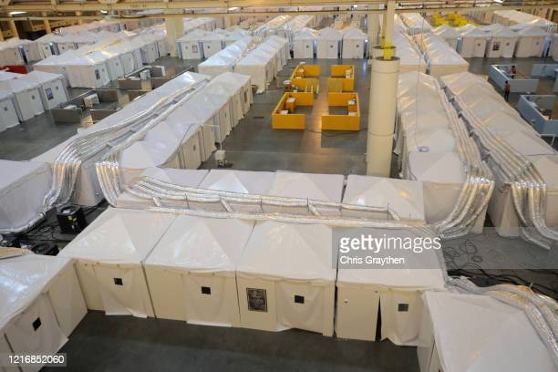 Members of the media tour the field hospital setup for coronavirus patients at the Ernest N. Morial Convention Center on April 04, 2020 in New...