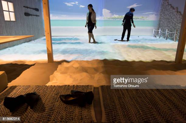 Members of the media try a virtual reality attraction at the VR Zone Shinjuku theme park operated by Bandai Namco Entertainment Inc on July 13 2017...