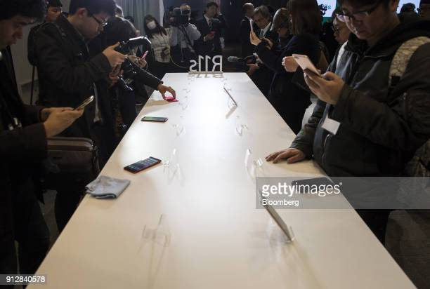 Members of the media try Oppo R11s smartphones during a launch event of the smartphone for the Japanese market in Tokyo Japan on Wednesday Jan 31...