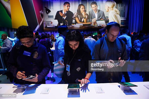 Members of the media try out the Samsung Electronics Co Galaxy Tab S tablet computer during the Galaxy Premier 2014 event in New York US on Thursday...