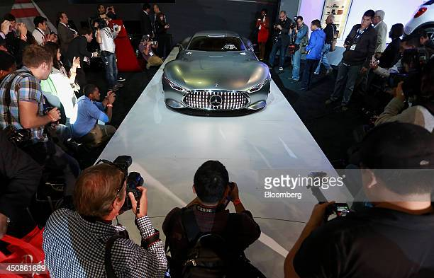Members of the media view a Daimler AG MercedesBenz Vision Gran Turismo concept vehicle during the LA Auto Show in Los Angeles California US on...