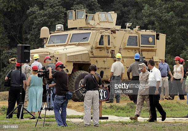 Members of the media view a Mine Resistant Ambush Protected vehicle or MRAP on the test course at the US Army's Aberdeen Proving Ground in Aberdeen...