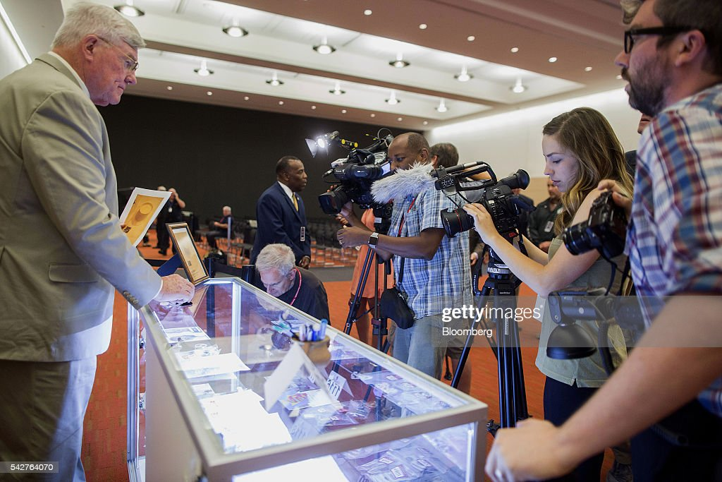 Members of the media view items belonging to notorious Boston mobster James 'Whitey' Bulger displayed during a press preview before an asset-forfeiture auction in Boston, Massachusetts, U.S., on Friday, June 24, 2016. The U.S. Marshals Service auctioned off items seized in 2011 from the Santa Monica hideout of the Bulger and his girlfriend, Catherine Greig. Photographer: Scott Eisen/Bloomberg via Getty Images