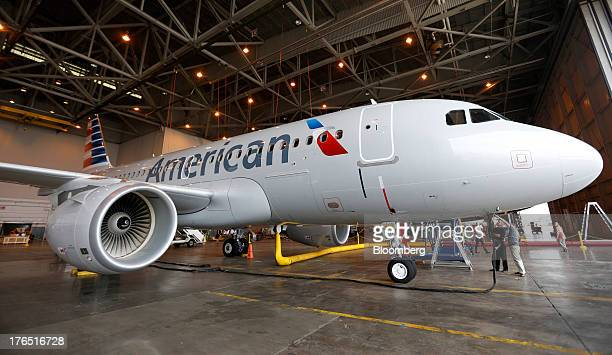 Members of the media view the American Airlines Inc Airbus A319 at Dallas Fort Worth Airport in Fort Worth Texas US on Wednesday Aug 14 2013 AMR Corp...