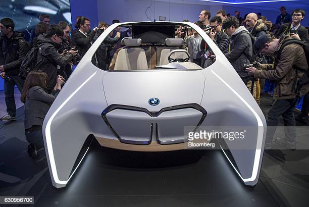 Members of the media view the BMWi Inside Future concept vehicle during a press event at the 2017 Consumer Electronics Show in Las Vegas Nevada US on...
