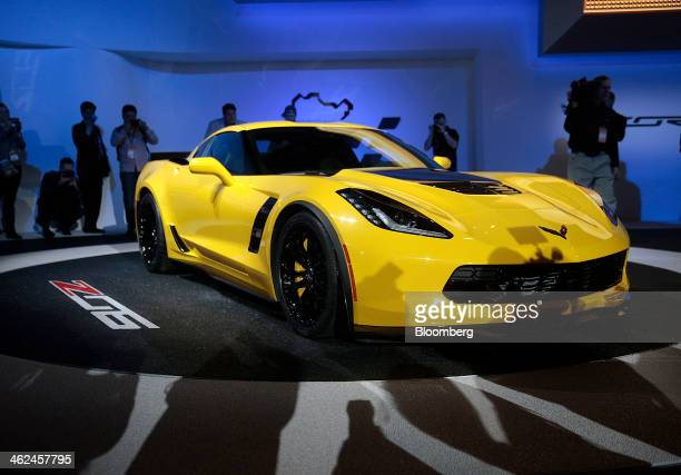 Members of the media view the Chevrolet Corvette Z06 after it is unveiled during the 2014 North American International Auto Show in Detroit Michigan...
