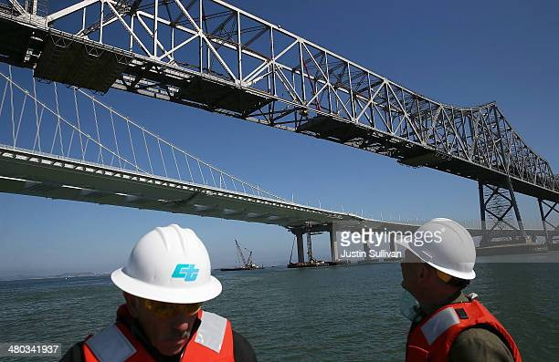 Members of the media view the demolition of the old eastern span of the San FranciscoOakland Bay Bridge during a tour of the demolition site on March...