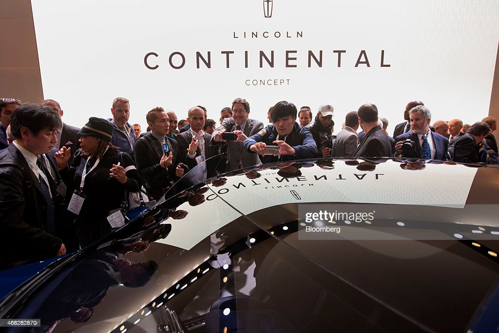 Members of the media view the Ford Motor Co. 2016 Lincoln Continental luxury sedan concept vehicle during the 2015 New York International Auto Show in New York, U.S., on Wednesday, April 1, 2015. Ford Motor Co.'s lagging Lincoln line, searching for a return to relevance, is dusting off the old Continental model name that had its heyday in the Mad Men era and was favored by President John F. Kennedy Photographer: Michael Nagle/Bloomberg via Getty Images